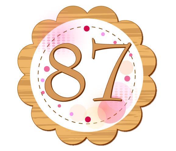 87が中心に描かれている円形のイラスト